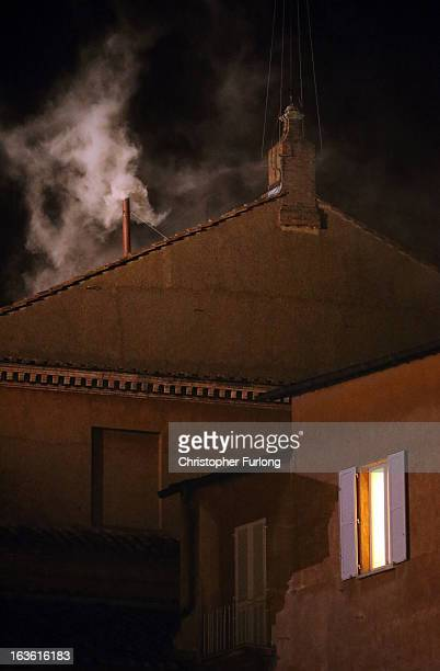 White smoke emerges from the chimney on the roof of the Sistine Chapel indicating that the College of Cardinals have elected a new Pope on March 13...