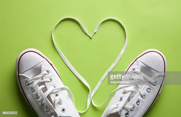 white sneakers in love - lace stock pictures, royalty-free photos & images