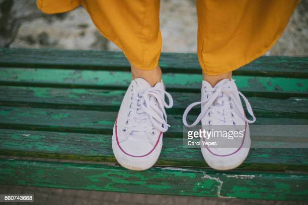 white sneakers viewpoint - kerb stock pictures, royalty-free photos & images