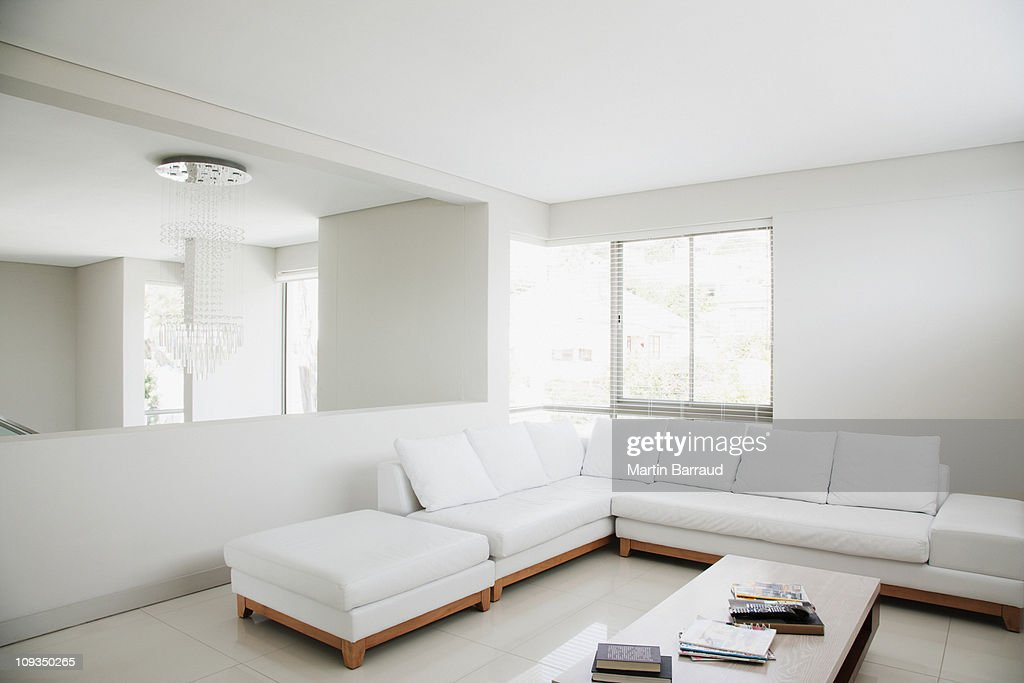 White sofa and mirror in modern living room : Stock Photo