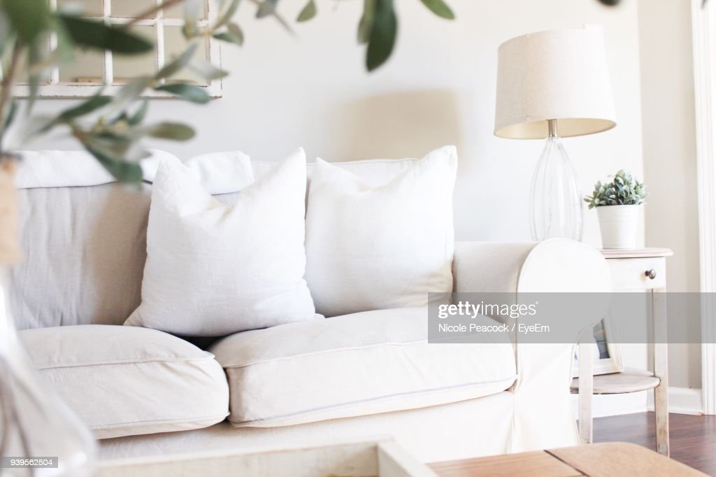 White Sofa By Table At Home : Stock Photo