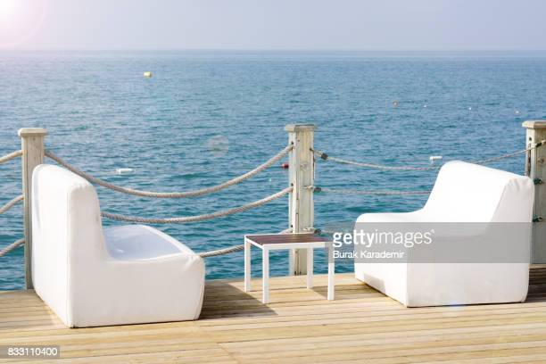 White sofas on pier by the sea