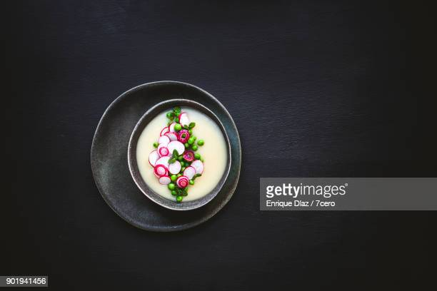 White soup with peas and radishes