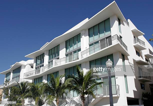 white south beach condo with palm trees - miami florida stock pictures, royalty-free photos & images