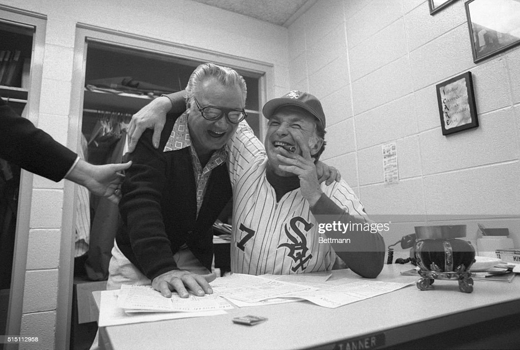 White Sox announcer, Harry Caray (L) and Sox manager, Chuck Tanner, are all smiles and cigar after an open discussion in Tanner's office with Chicago sports' writers present. Allegedly Tanner had become upset about remarks Caray made about a pitching change made in game with Boston and broadcasted 6/9.