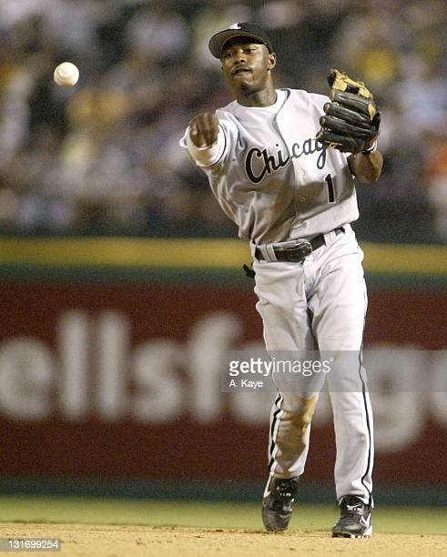 White Sox second baseman Willie Harris flips to Paul Konerko for the last out in inning. The Rangers beat the White Sox 6-4 at Ameriquest Stadium in...