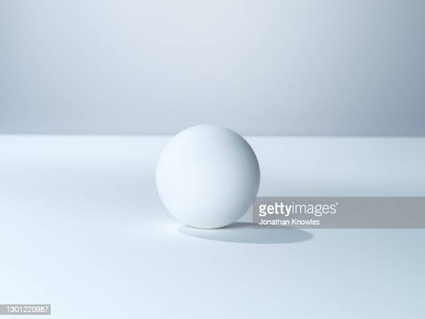 white sphere - ball stock pictures, royalty-free photos & images