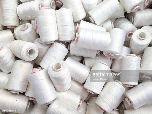 White spools of thread