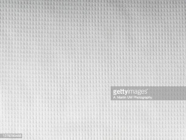 white sport shirt texture background. detail of luxury fabric surface. - t shirt stock pictures, royalty-free photos & images
