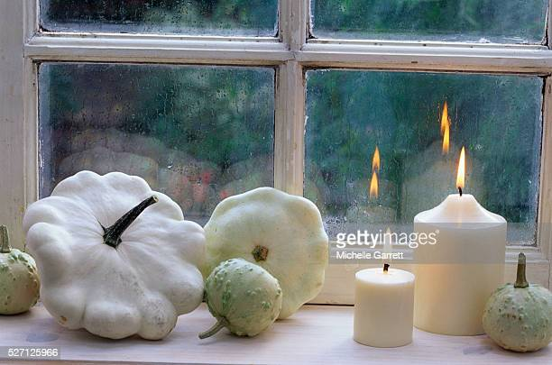 White Squash and White Candles on Window Sill