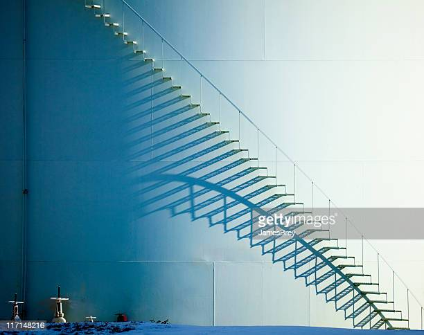white staircase and shadow on oil storage tank - gas refinery stock photos and pictures