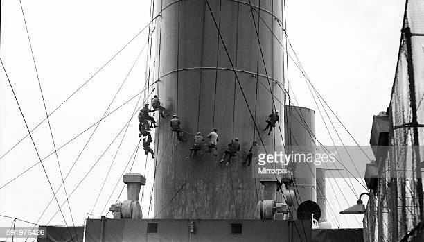 White Star Line liner RMS Olympic sistership of the ill fated Titanic seen here having her funnels painted during her yearly refit at Southampton...