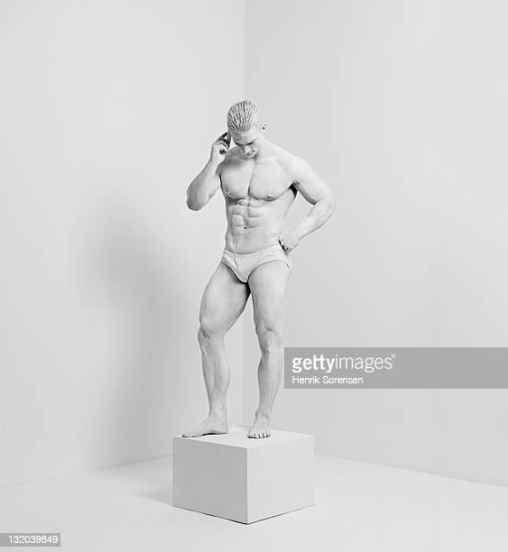 white statue in white room