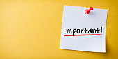 White Sticky Note With Important And Red Push Pin On Yellow Background