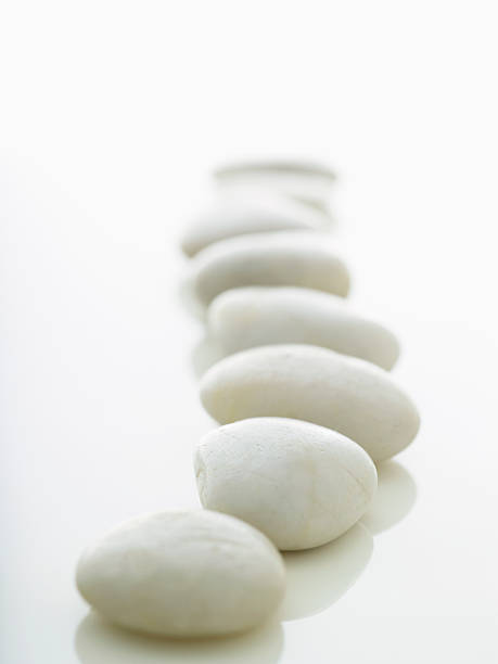 white stones lined up on a white background