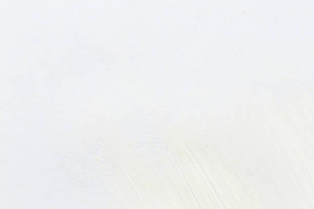 White stroke of paint brush on white paper sketch