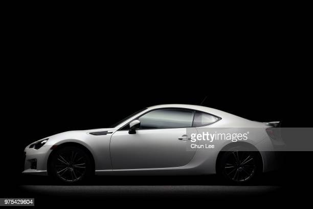 white subaru car on a black background - motor vehicle stock pictures, royalty-free photos & images