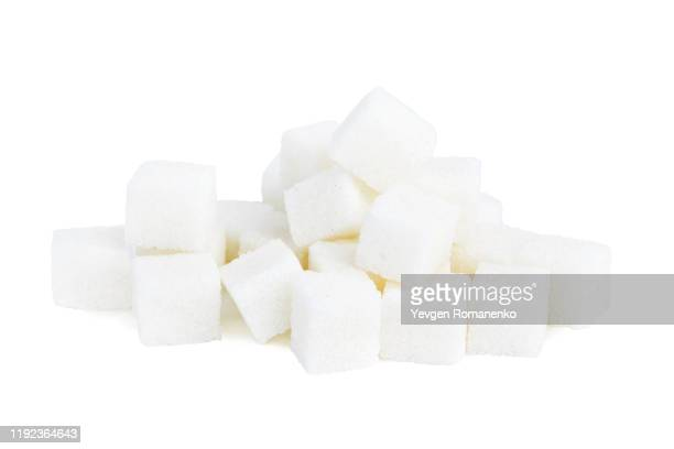 white sugar cubes isolated on white background - sucre photos et images de collection