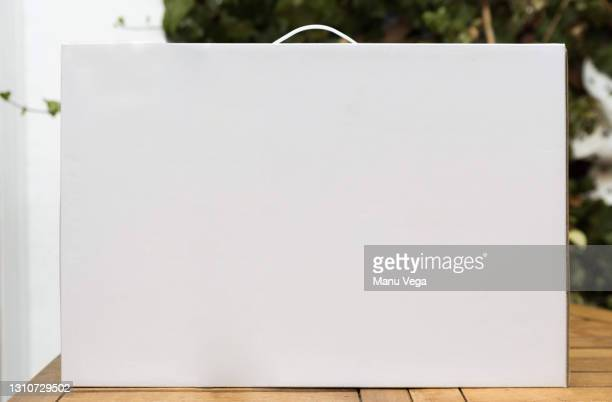 white suitcase on a wooden table. - id card template stock pictures, royalty-free photos & images