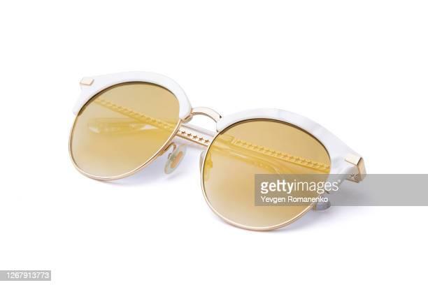 white sunglasses isolated on a white background - sunglasses stock-fotos und bilder