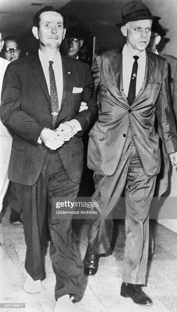 White supremacist and Klansman Byron de la Beckworth is escorted by FBI agents into the Jackson police station for arraignment on federal charges in the ambush murder of integration leader Medgar Evers, Jackson, Mississippi, June 23, 1963.