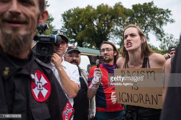 White supremacist racist organization Ku Klux Klan members argue with a counter protester during a rally in Madison Indiana United States on August...