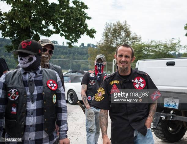 White supremacist racist organization Ku Klux Klan members come face to face with protesters during a rally in Madison Indiana United States on...