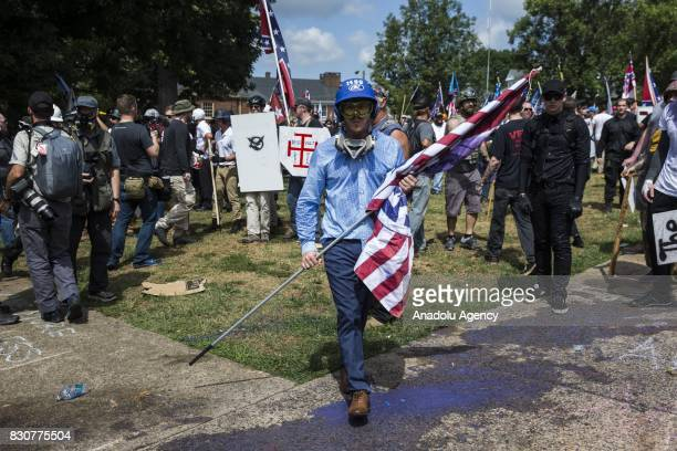A White Supremacist with a White Nationalist flag during clashes with counter protestors at Emancipation Park where the White Nationalists are...
