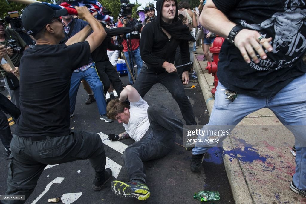 White Supremacists and counter protestors clash at Emancipation Park where the White Nationalists are protesting the removal of the Robert E. Lee monument in Charlottesville, Va., USA on August 12, 2017.
