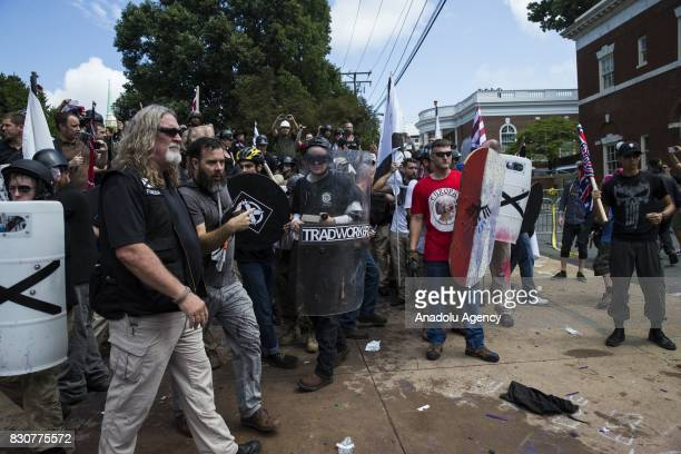 White Supremacists holds a line with shields and sticks during clashes with counter protestors at Emancipation Park where the White Nationalists are...