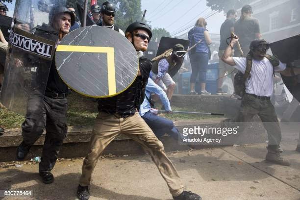 White Supremacists rush forward with shields and sticks during clashes with counter protestors at Emancipation Park where the White Nationalists are...