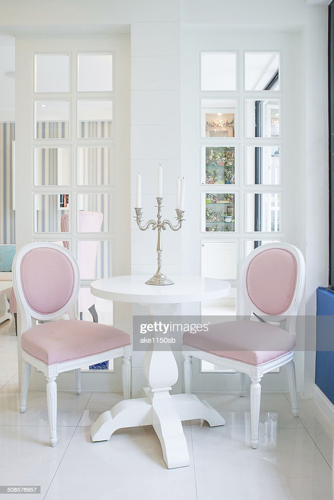 White table and pink chair with candle in living room : Stock Photo