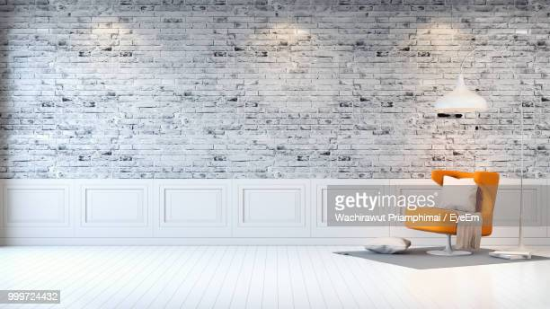 white table on wall at home - empty room stock pictures, royalty-free photos & images