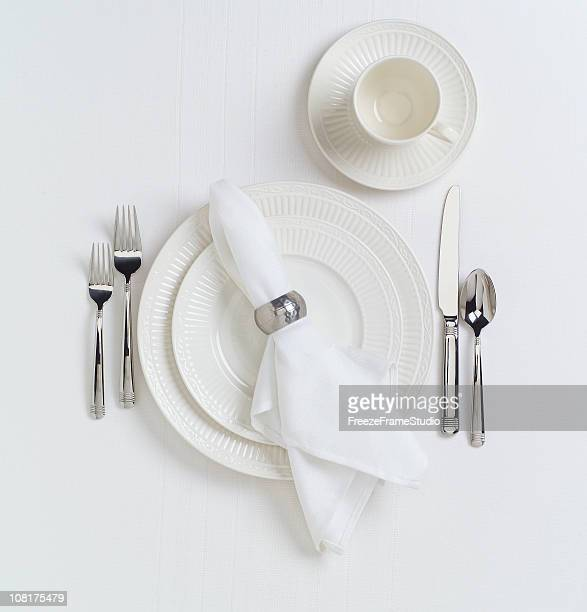 white table place setting with dishes - silverware stock pictures, royalty-free photos & images