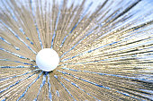 white table tennis ball pushes through