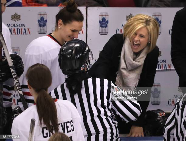 TORONTO ON FEBRUARY 11 White team coach and former Olympian Tessa Bonhomme has a laugh behind the bench as she greets the officials prior to the...