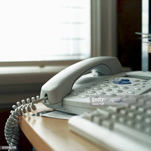 white telephone on table - dana white stock pictures, royalty-free photos & images