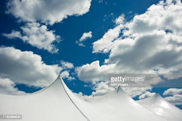 white tent top against a cloudy sky - wellesley massachusetts stock pictures, royalty-free photos & images