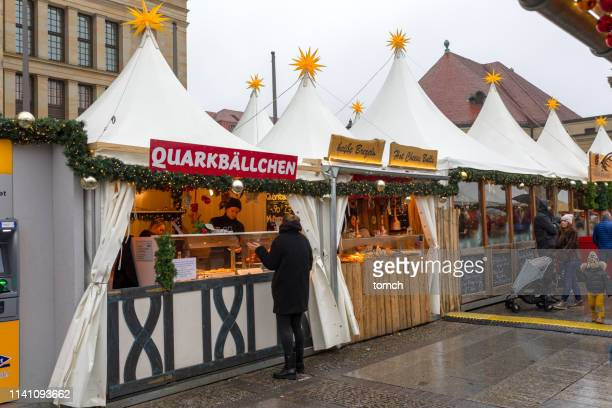 white tents at the gendarmenmarkt  cristmas market in berlin - gendarmenmarkt stock pictures, royalty-free photos & images