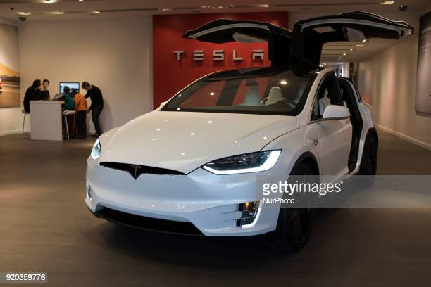 A white Tesla Model X parked inside Tesla store in Stanford Shopping Center on February 13 Palo Alto California