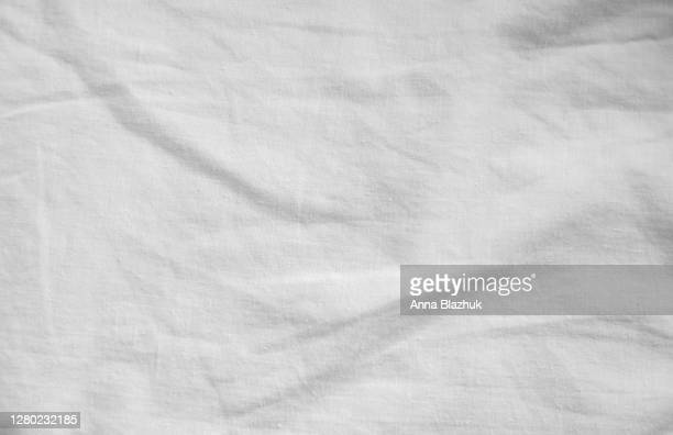white textile fabric abstract textured background - materiale tessile foto e immagini stock