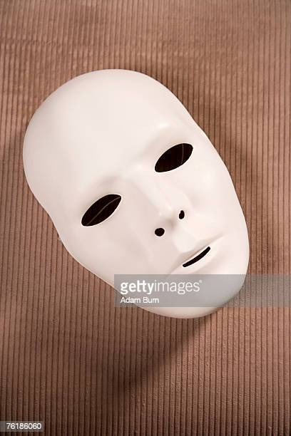A white theater mask