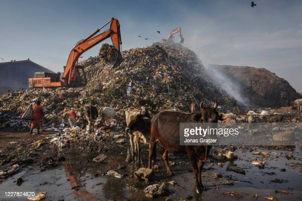 White thick smoke of methane gas seeps up between the layers of garbage and waste at the dumping zone of Belgharia, that since 2008 lets out...