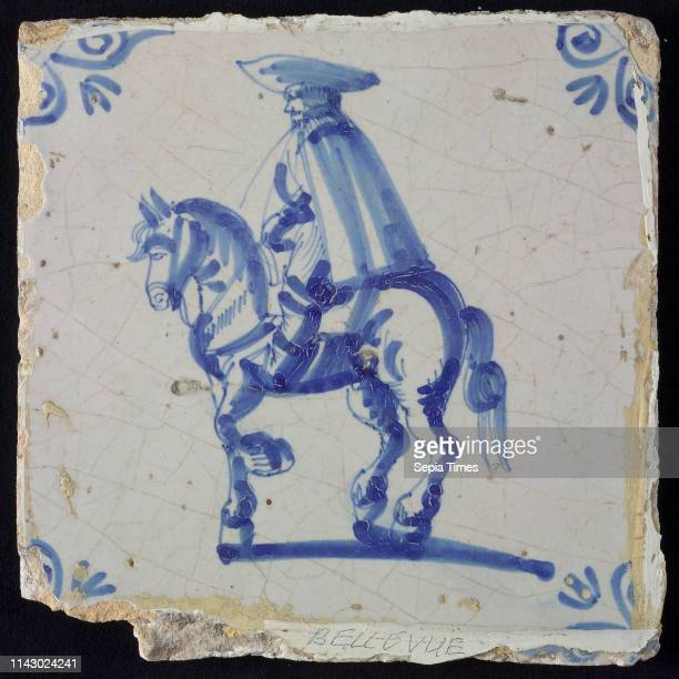 White tile with blue rider with cape and hat corner pattern ox head wall tile tile sculpture ceramic earthenware glaze baked 2x glazed painted on...