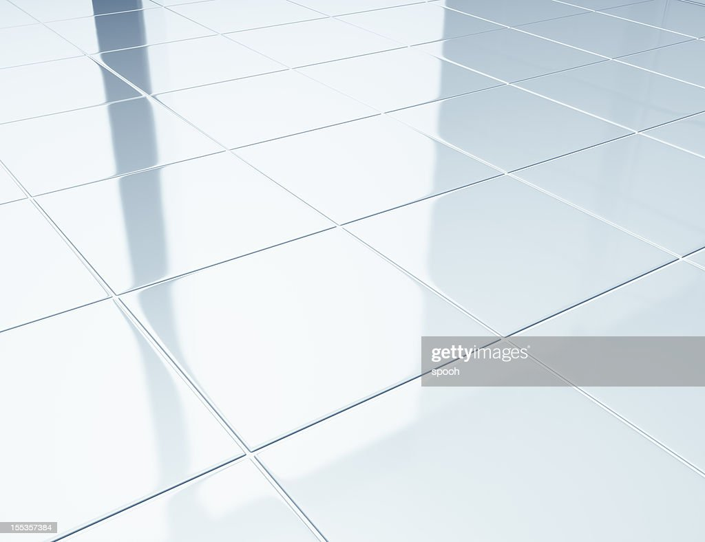 White tiles on a floor in bathroom : Stock Photo
