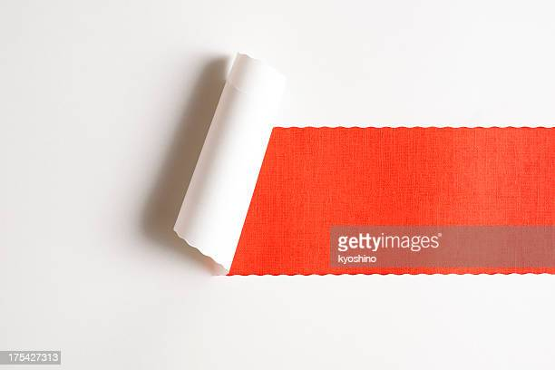 White torn paper on orange paper background