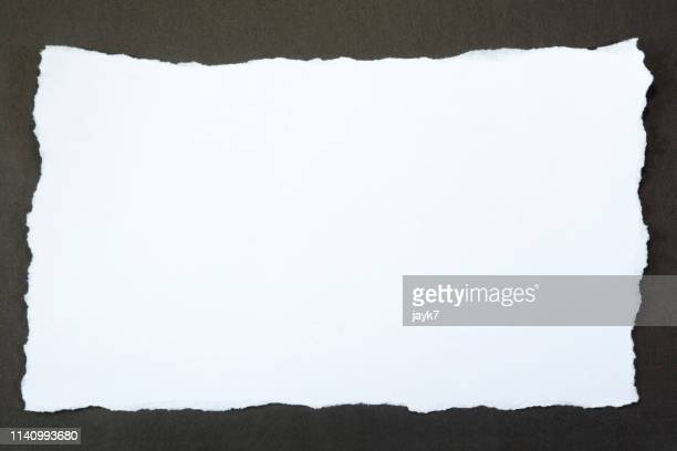 white torn paper - at the edge of stock pictures, royalty-free photos & images