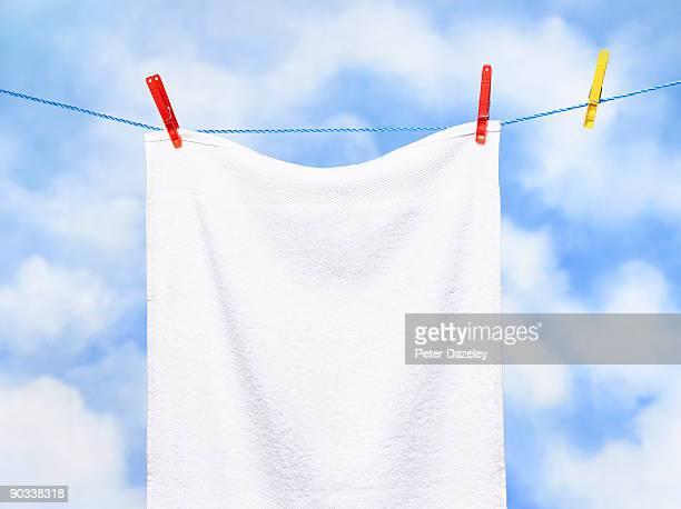 white towel on washing line. - タオル ストックフォトと画像