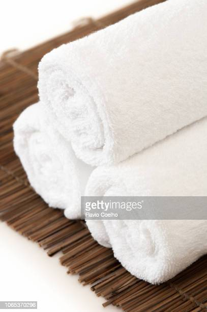 White towels on straw mat