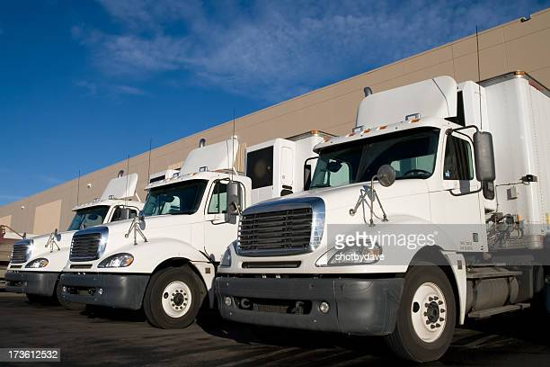 White Transportation Trucks at a Warehouse